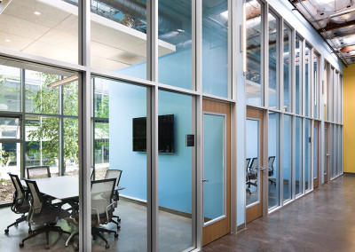 View from the corridor along the line of meeting rooms through to the courtyard space.