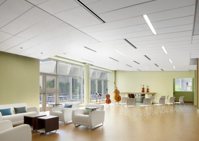 Performance/reception space: The ceiling was folded in server locations and the set at angles to enhance the acoustical properties of the space.