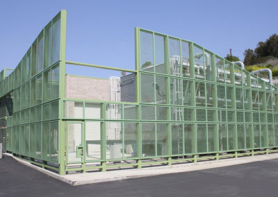 The equipment screen enclosure geometry has a dynamic relationship with the ground-mounted cooling tower in the equipment yard.