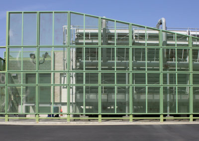 The Central Plant cooling tower as seen through the perforated metal screen enclosure.
