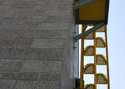 The roof access stair, viewed from below. The coursed of 4 inch block that were initiated as accent coursed in the glazed block of the southwest corner extend around the entire building perimeter.