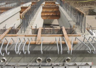 Precast beams in preparation for roadbed reinforcing