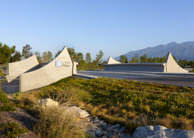 Wing walls flank both sides of the roadway, on both sides of the channel. They were shaped to evoke the mountains to the north and form a gateway to the main part of campus.