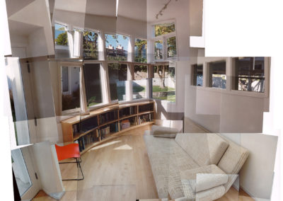 The family room is the only ground-floor space that utilizes the curved geometry, a strategy that unifies the overall composition. It also allowed the room to have the required area and not violate required setbacks from the adjacent studio building (visible through the windows to the right).